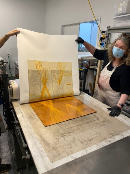 Katherine pulling a proof off a large intaglio plate