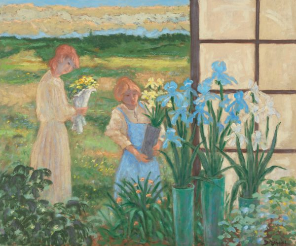 Two ladies standing in an open greenhouse