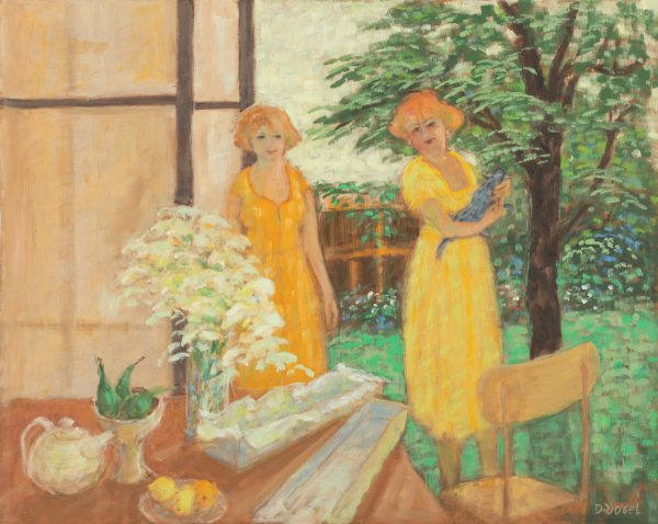 Two ladies standing behind a table, one with a cat