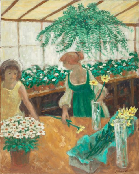Two ladies standing in a greenhouse